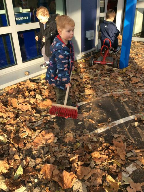 Sweeping up the leaves.