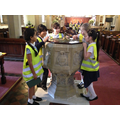 Examining the font at the back of the church.