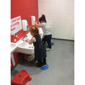 Washing our hands, remembering to use soap!