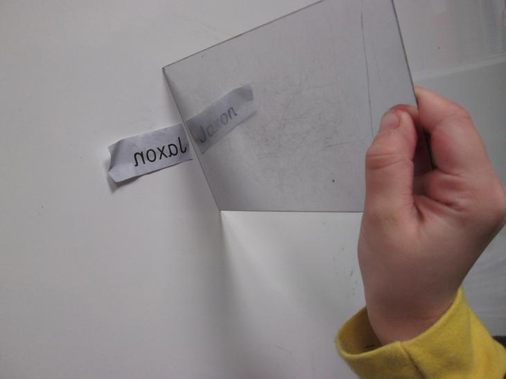 Finding our names using a mirror.