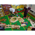 We have been arranging the wooden shapes