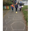 Shape challenge throwing game! I can name the shapes and tell you how many sides they have