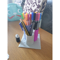 Evie has created her own pencil pot!