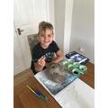 Ethan designing his Mayan Mask