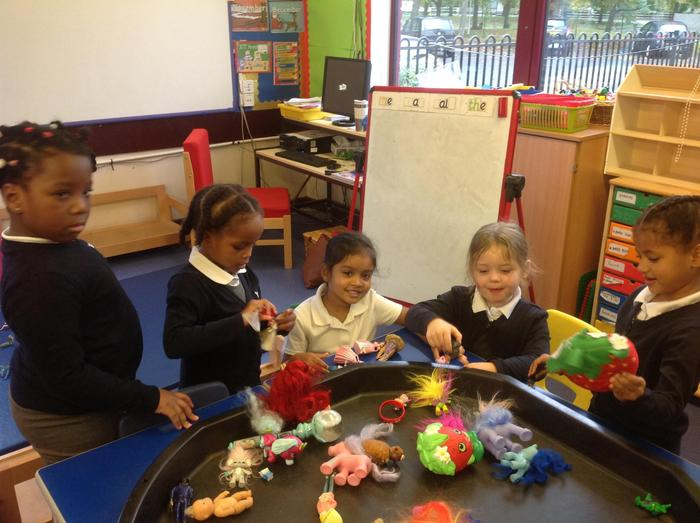 Making up stories with small toys! Every day is an adventure in Rio class.