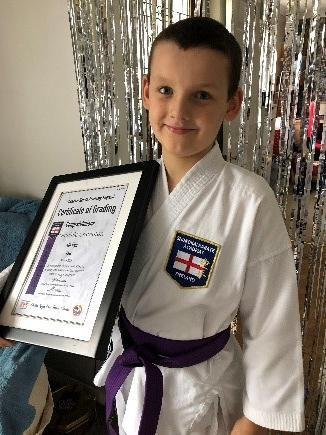 Dom continued training through lockdown and received his purple belt in karate!