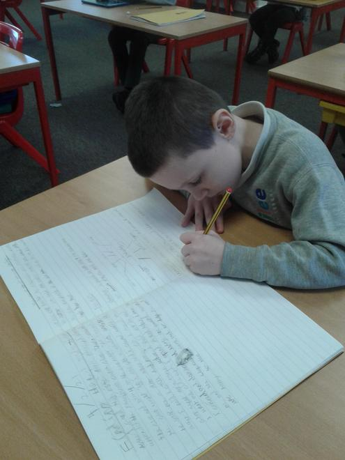Riley writing up his English and Topic work on his healthy diet.