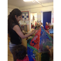 Helping to decorate our rocket!
