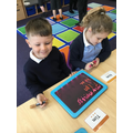 Phonics: read, write, cover, check on the light boards