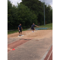 Kieran soars during his triple jump!