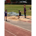 Harry flies through the air during his long jump.