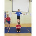 Advanced balancing skills in Year 6 gymnastics.