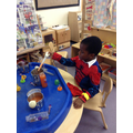 Developing fine motor skills with coloured water