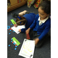 using the letter tiles to create words