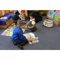 Sharing books and jigsaws