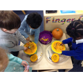 Scooping out pumpkins