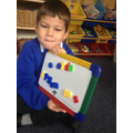 Using magnetic letters to build words