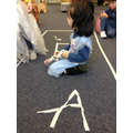 using the tape to create letters