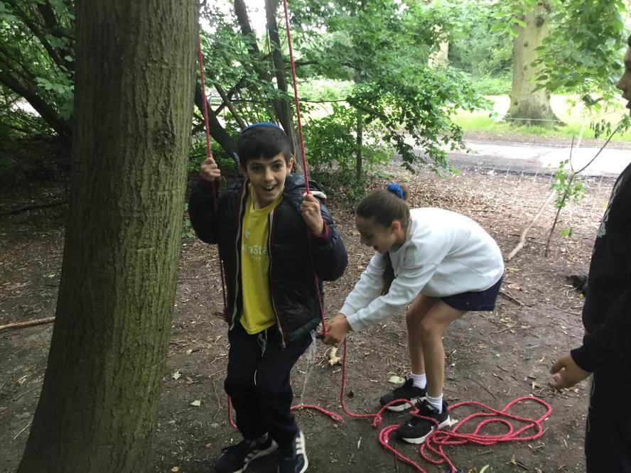 Forest school creating a swing