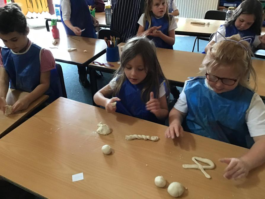 Making salt dough 'tudor knots'.