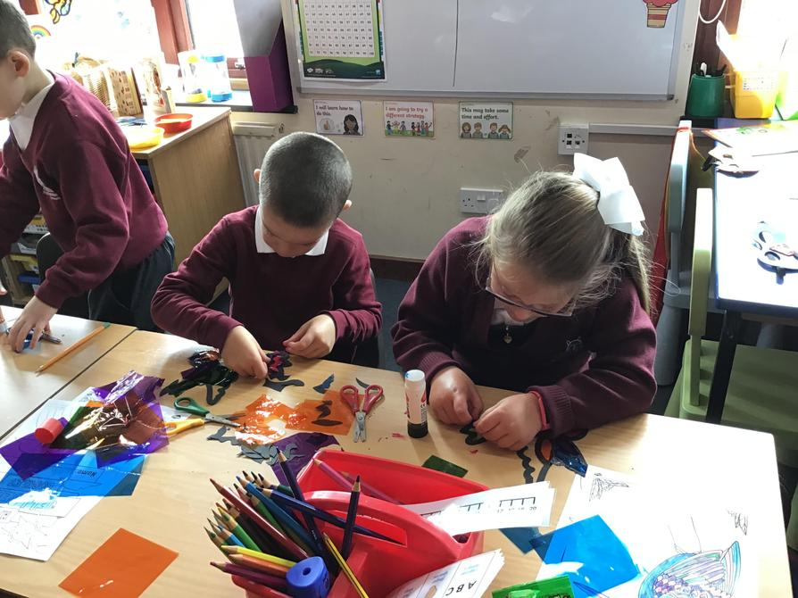 Making our stained glass effect birds to celebrate our new class names.