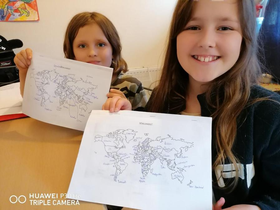 Georgia and her sister doing some Geography.