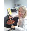 Rosie is enjoying helping cook tea for her family!