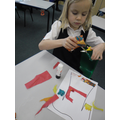 Ivy practised using scissors to make her collage.
