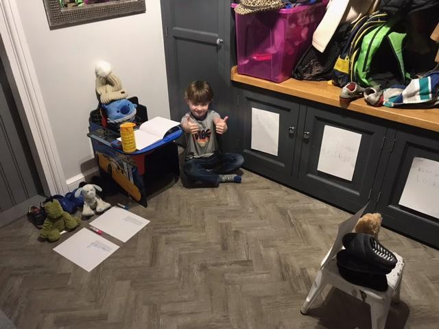 Jackson has a classroom set up for his teddies.
