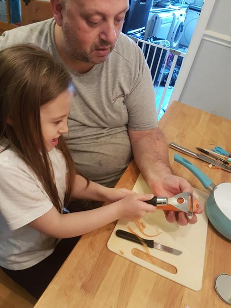 Amelia and her dad making soup