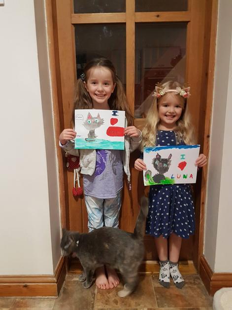 Arya and Elsie's drawings of their cat, Luna.