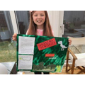 Scarlett with her non-fiction poster on dinosaurs.