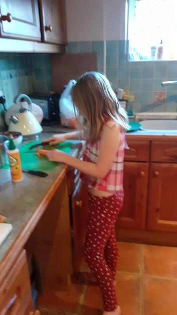 Isabelle chopping vegetables