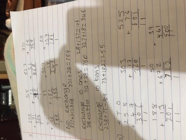 Emi's working hard in Maths!