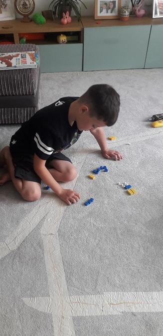 Rhydian using lego for his Maths