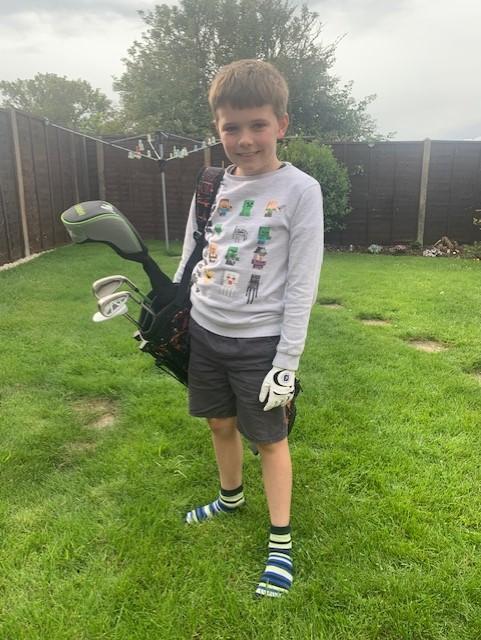 Lewis has taken up a new sport - golf!