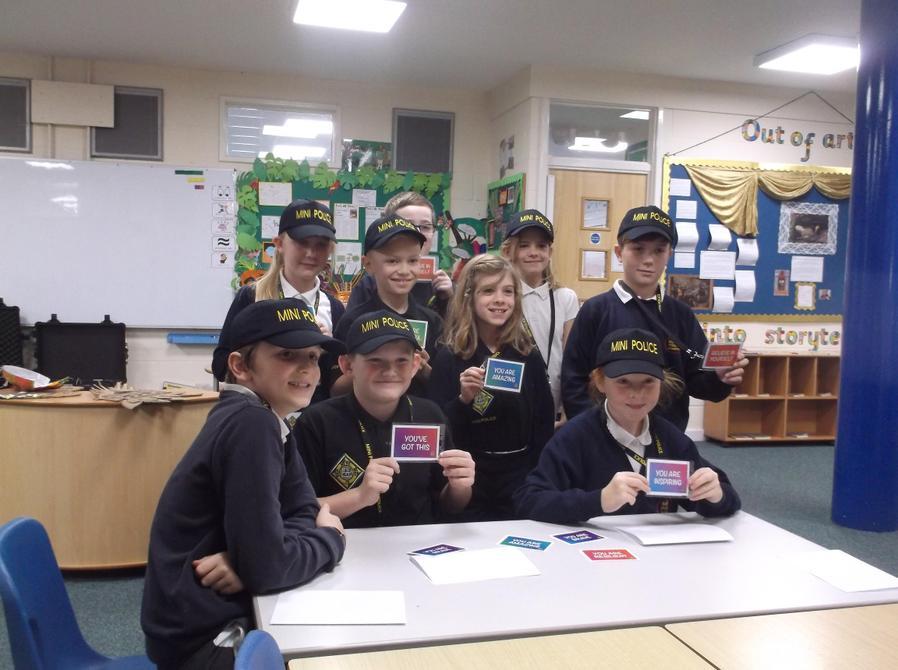 Mini Police with their RAK cards ready to spread kindness everywhere!