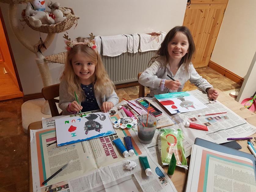 Arya and Elsie are doing art work.