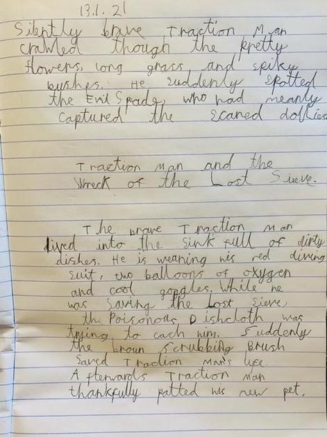 Emilis has written his Traction Man in his lovely joined handwriting.