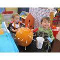 Hammering golf tees in to pumpkins!
