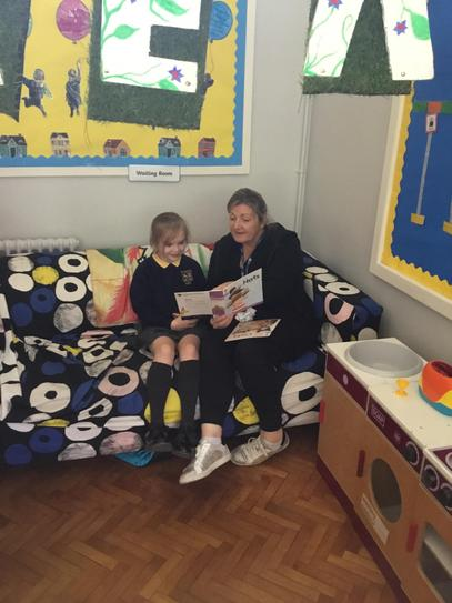 Lola did lovely reading with Mrs Lemon during play