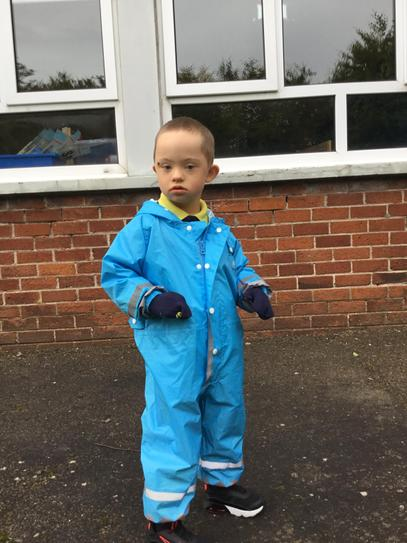 How cute is Jake in his puddle suit?!