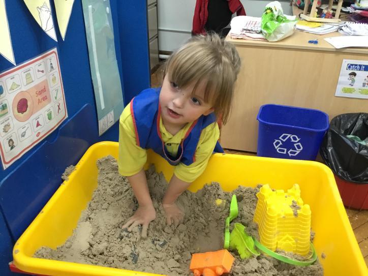 Olivia loves the sand.