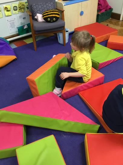Olivia enjoying the large soft blocks.