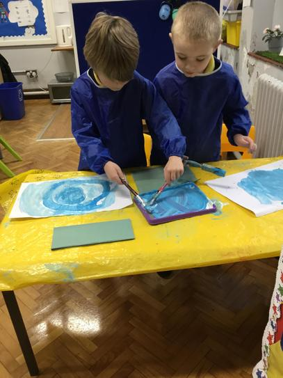 Mason & Lucas worked together to paint Neptune & Uranus