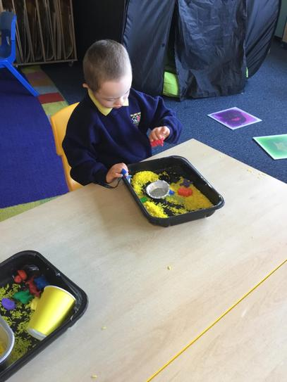 Jake loved playing in the sensory rice