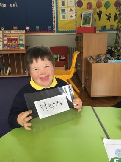 Harry worked hard to write his name during literacy
