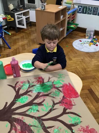 Sam adding his handprint to our friendship tree.