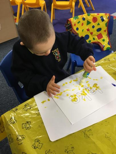 Jake really enjoyed using the bingo dabber to do some mark making.