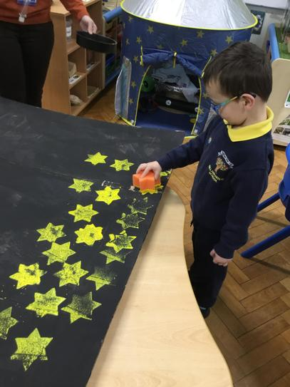 Jack stamping stars on the night sky.